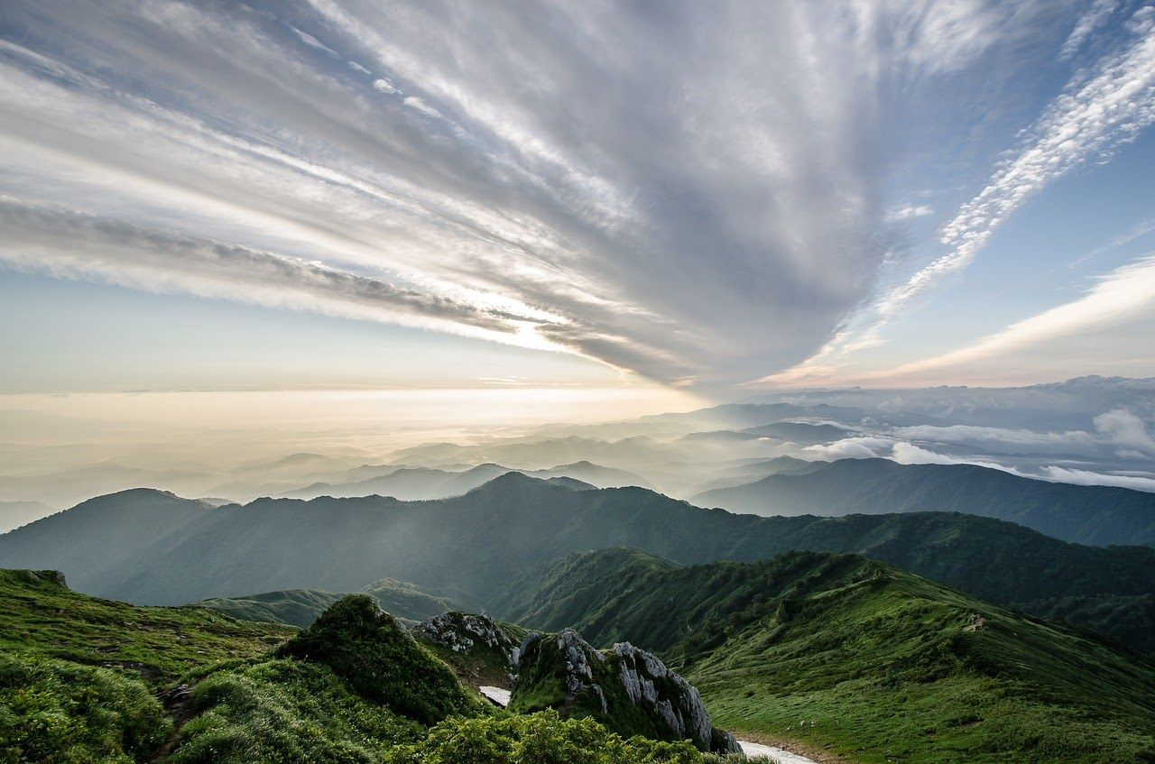 photo of a mountain landscape and cloudy sky