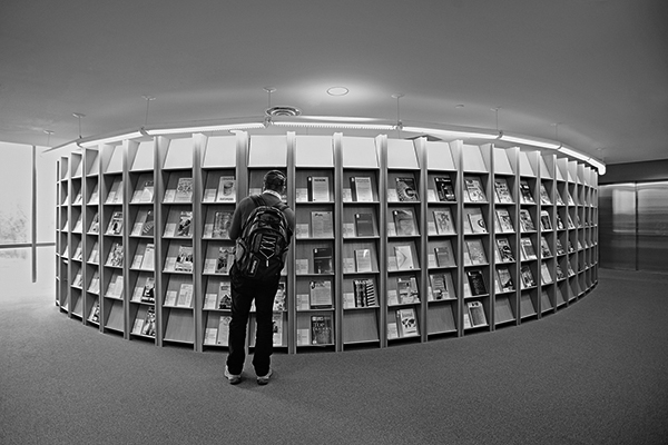 black and white photo of the Bronfman Library magazine rack