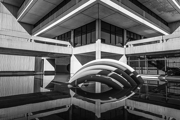 black and white picture of the rainbow sculpture at the back of Scott Library