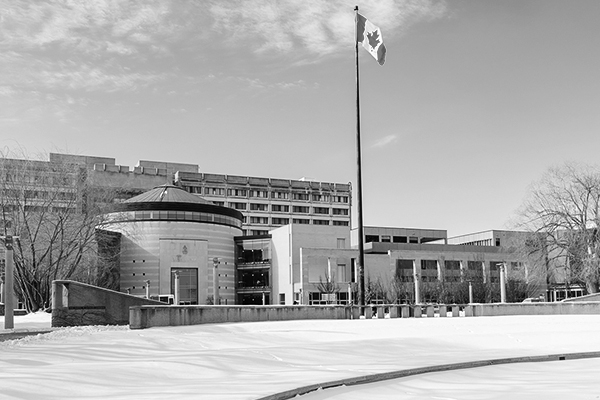black and white photo of Vari Hall and the flag pole